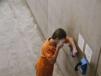 1146158537Inmate_on_phone