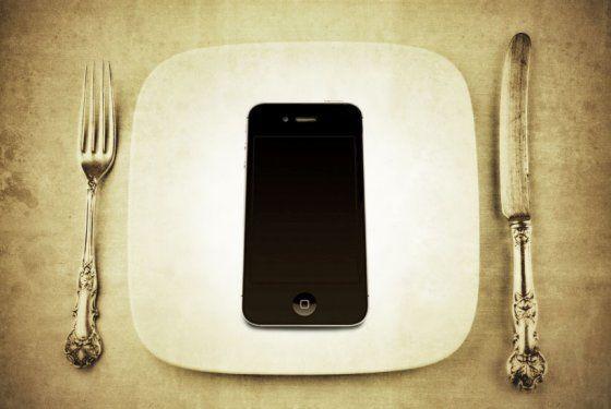 Het gebruiken van je smartphone in restaurants