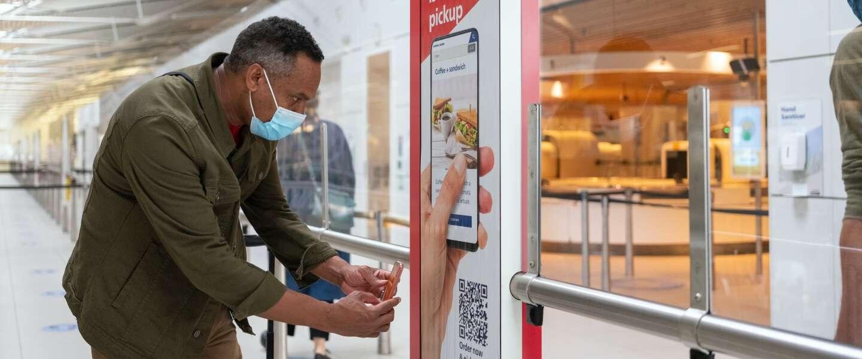 Overal op Schiphol eten en drinken bestellen via Schiphol app
